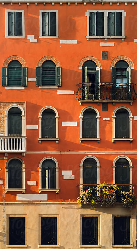 Antique building facade with windows and balconies.Venice/Italy by Marko Milanovic for Stocksy United