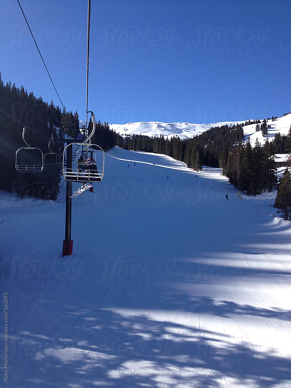 Mountains Views from the Ski Lift in Crested Butte, Colorado  by Abby Mortenson for Stocksy United