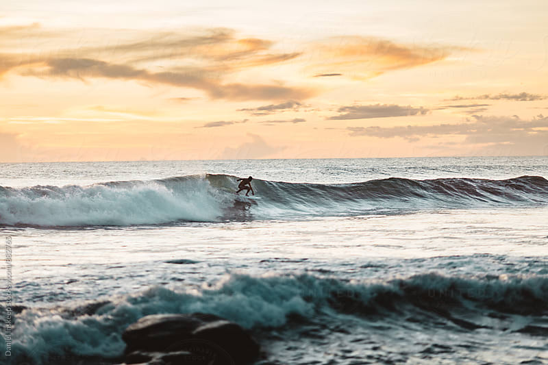 A Surfer Catching a Wave in Nicaragua by Daniel Inskeep for Stocksy United