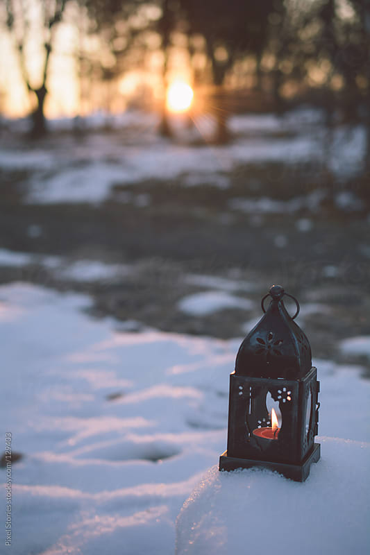 Christmas lantern on snow by Pixel Stories for Stocksy United