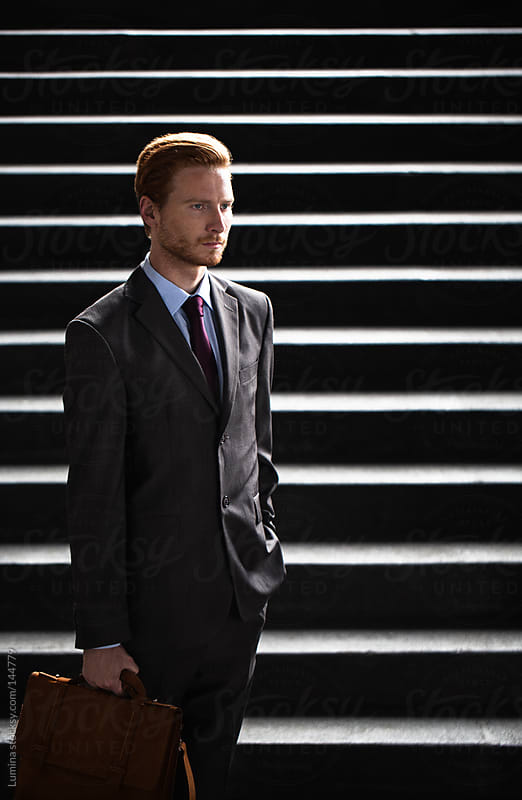 Serious Young Businessman Outdoors by Lumina for Stocksy United