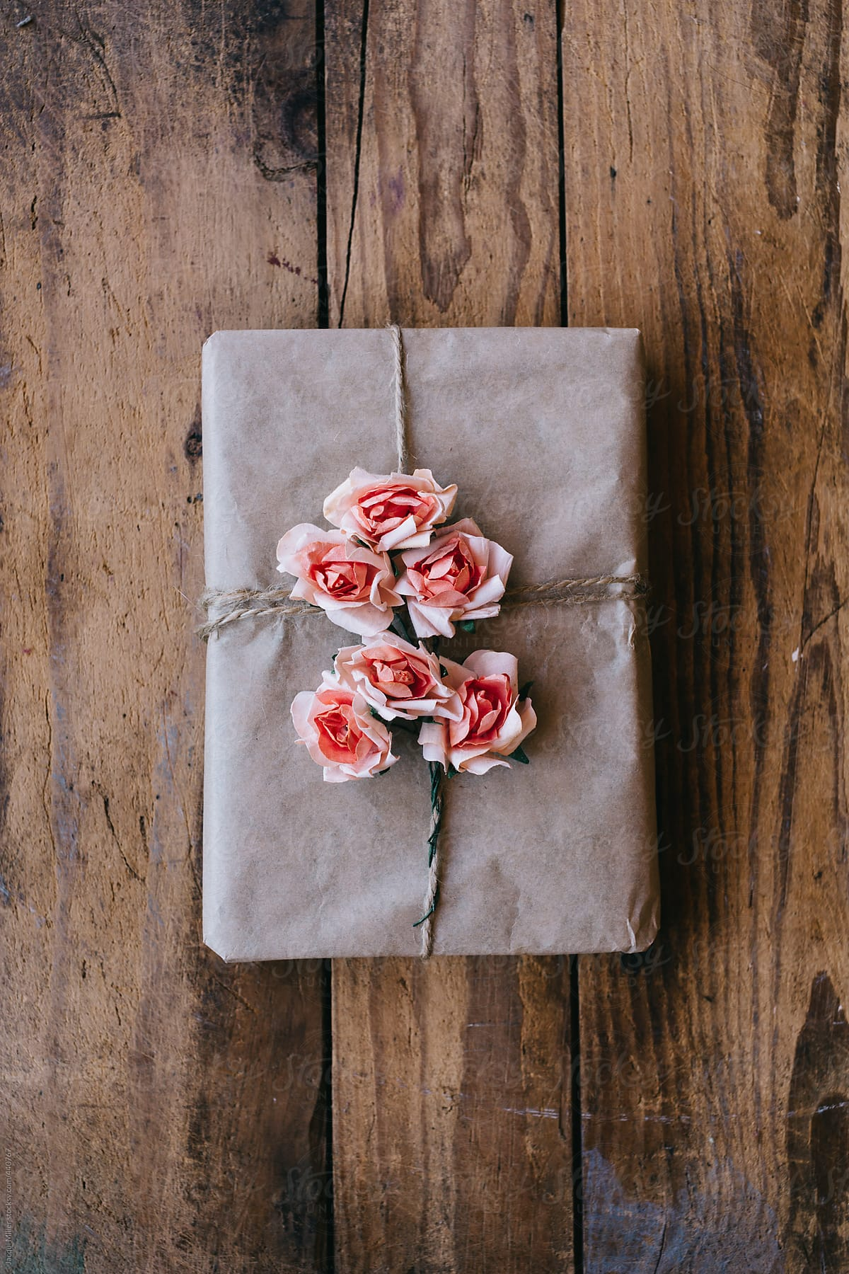 Gift wrapped in brown paper and decorated with bouquets of pink gift wrapped in brown paper and decorated with bouquets of pink flowers made from paper mightylinksfo