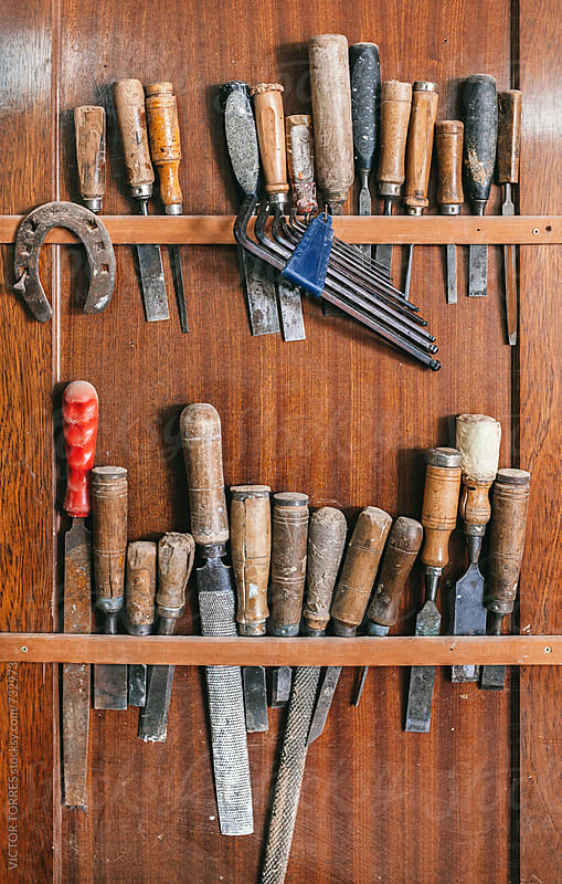 Old Carpenter Tools on a Wooden Wall by Victor Torres for Stocksy United