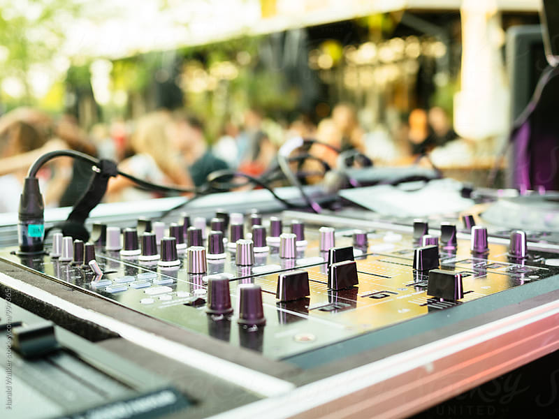 DJ equipment at an outdoor party by Harald Walker for Stocksy United