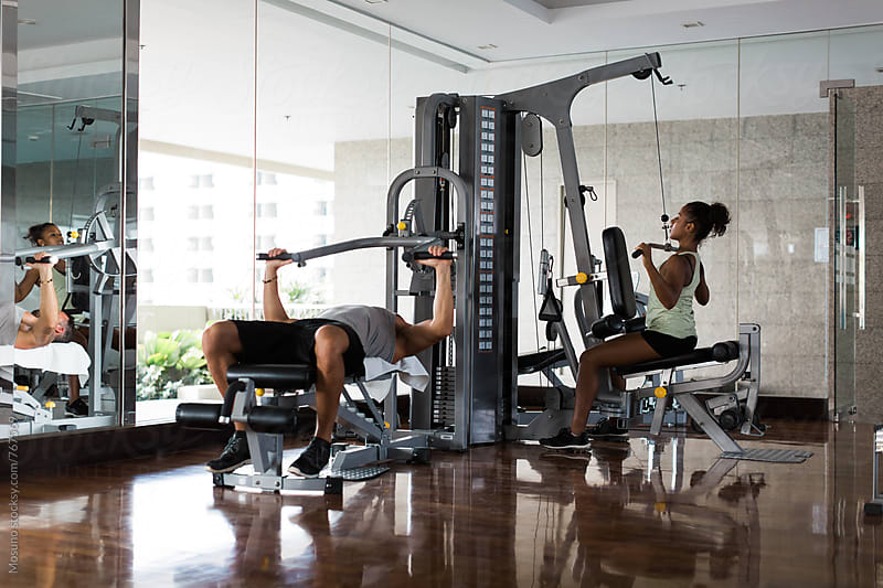 Two People Exercising in the Gym by Mosuno for Stocksy United