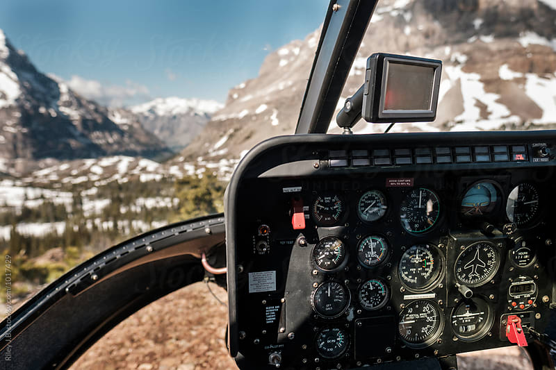 Cockpit of a helicopter landed in a meadow in the Rocky Mountains by Riley Joseph for Stocksy United