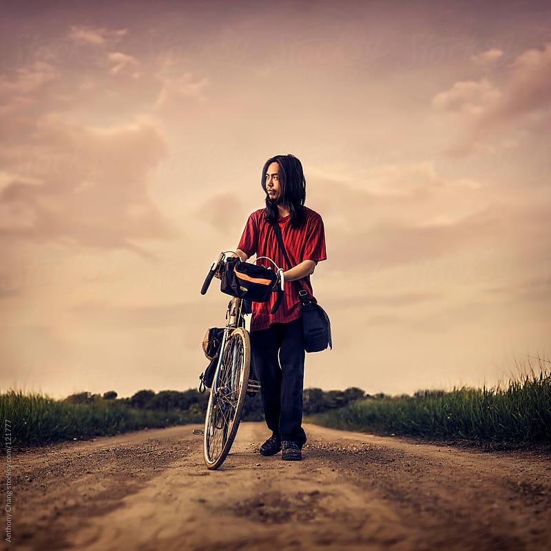 Walking Along with a Bike by Anthony Chang for Stocksy United