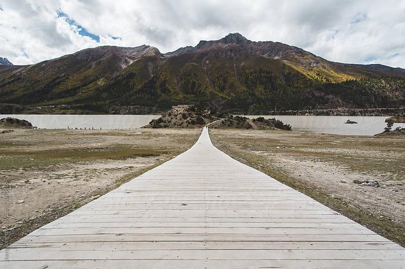 wooden path beside Ranwu lake in Tibet by zheng long for Stocksy United