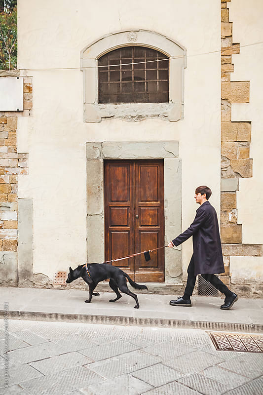 Young Adult Going Out with his Dog in Florence, Italy by Giorgio Magini for Stocksy United