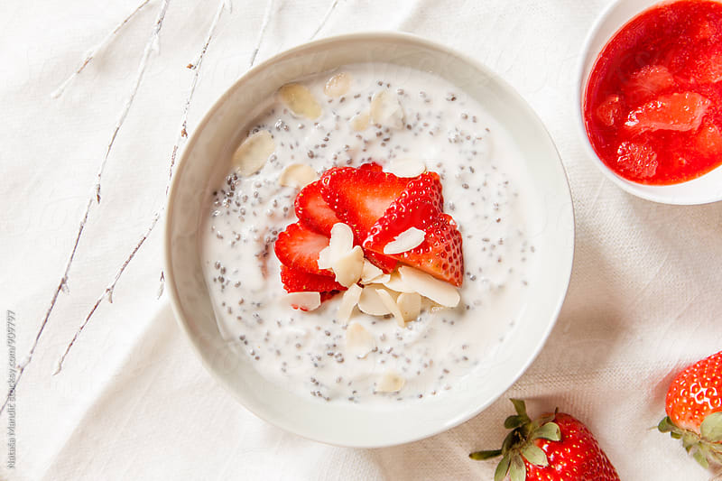 Chia pudding with strawberries and almonds by Nataša Mandić for Stocksy United