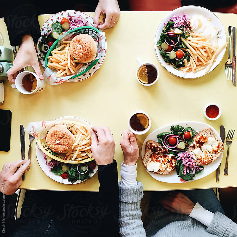 Lunch at a diner by Kirstin Mckee for Stocksy United