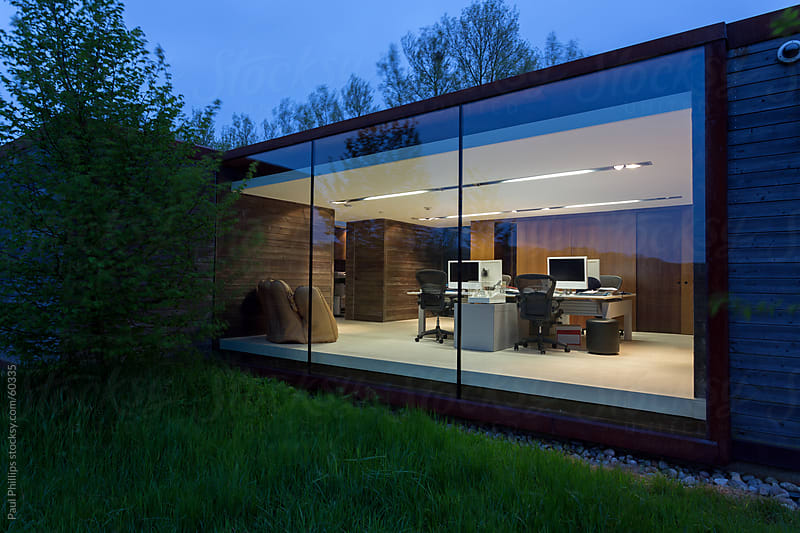 Modern office at twilight  by Paul Phillips for Stocksy United