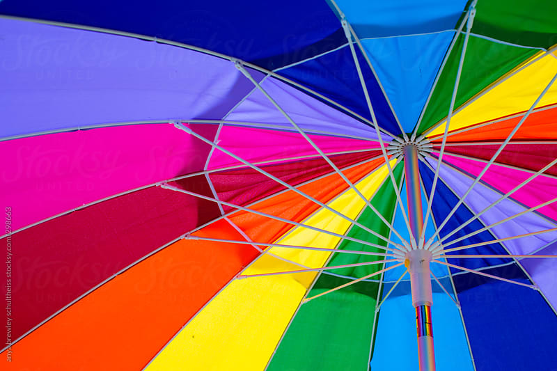 Closeup image of a rainbow coloured umbrella by anya brewley schultheiss for Stocksy United