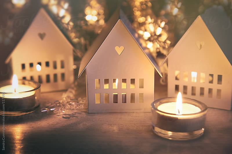 Little candle houses lit for Christmas by Sandra Cunningham for Stocksy United