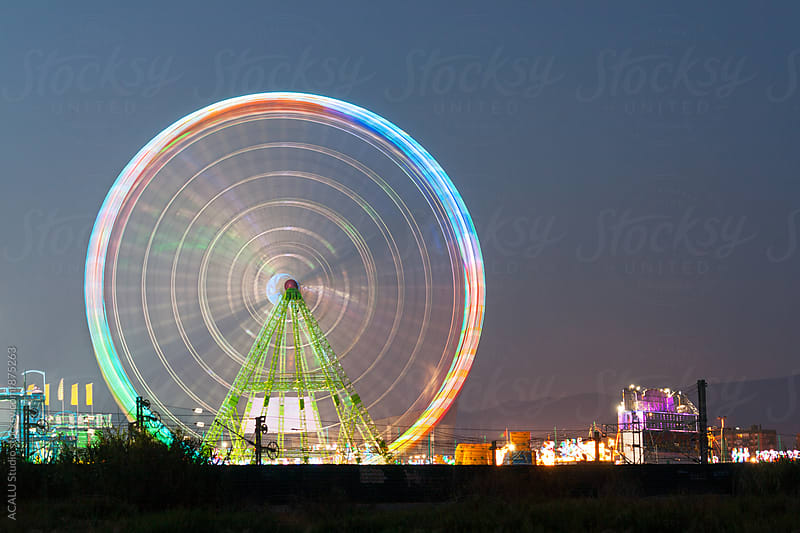 Ferris wheel at night by ACALU Studio for Stocksy United