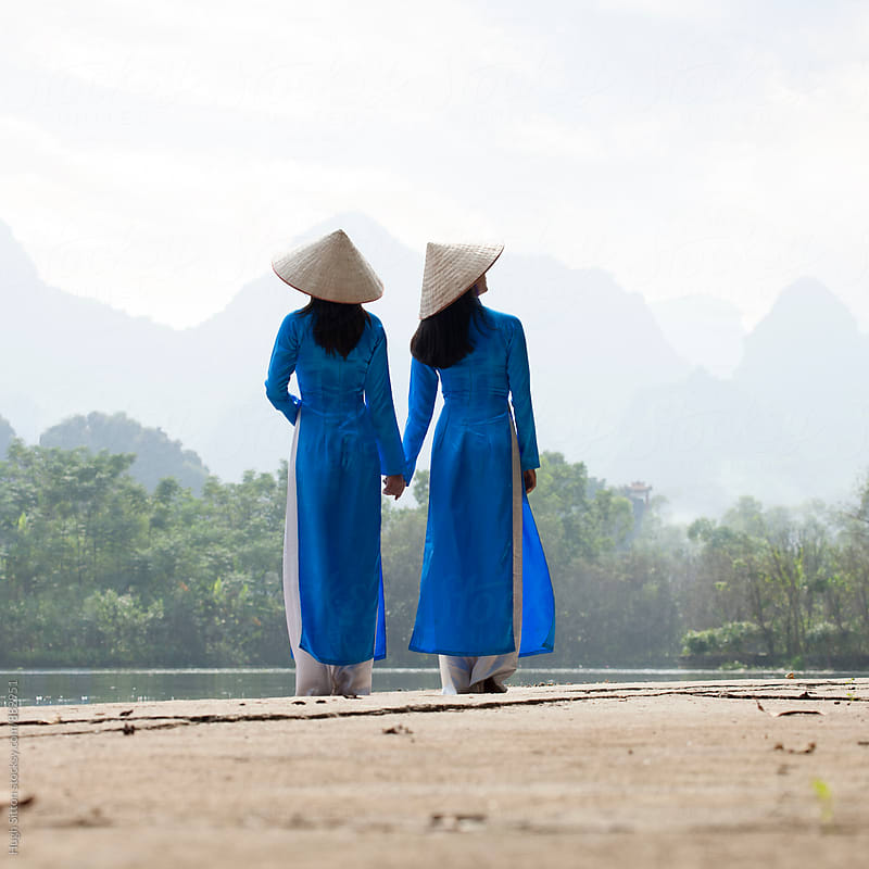 Vietnamese women in traditional costume. Vietnam by Hugh Sitton for Stocksy United
