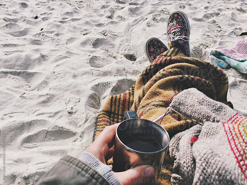 drinking wine and knitting at the beach by Jess Lewis for Stocksy United