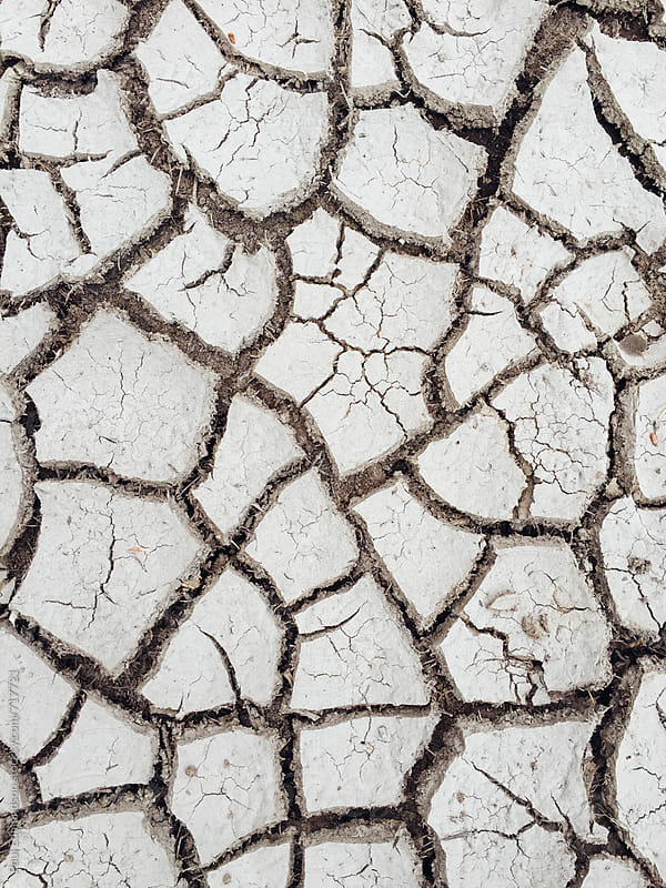Cracked soil from severe drough by Paul Edmondson for Stocksy United