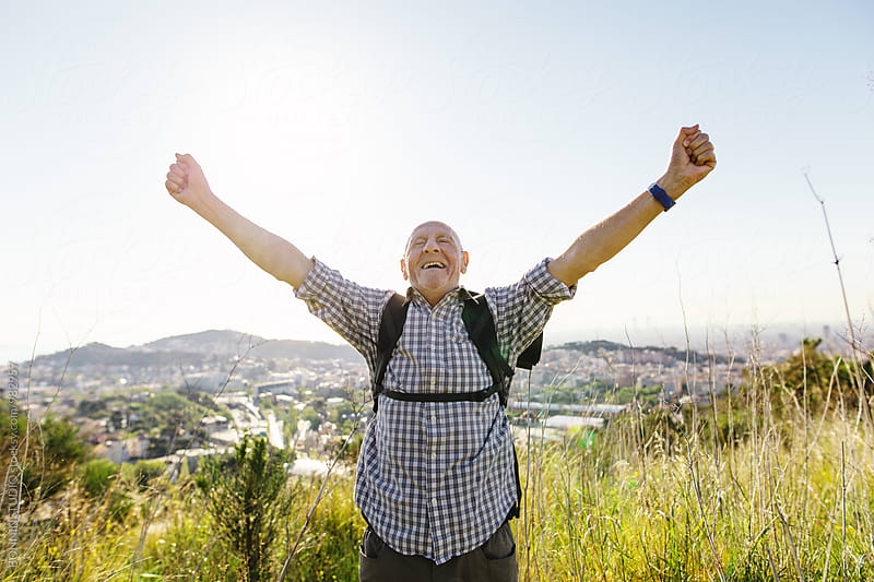 Happy senior man on a mountain in a sunny day. by BONNINSTUDIO for Stocksy United