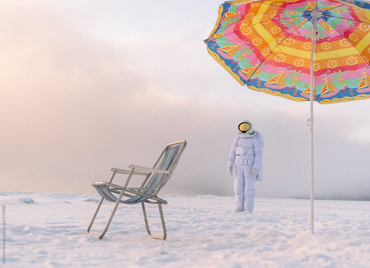 astronaut at lounger in winter stocksy united