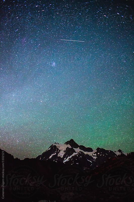 starry night sky over Mount Shuksan, Washington by Cameron Zegers for Stocksy United