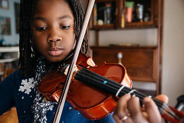 Black girl playing violin by Gabriel (Gabi) Bucataru