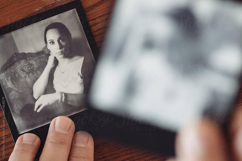 Examining Black and White Polaroid Portraits by Geoffrey Hammond for Stocksy United