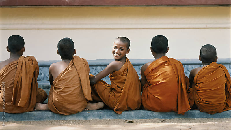 Young novice monks sitting outside monastery. Sri Lanka by Hugh Sitton for Stocksy United