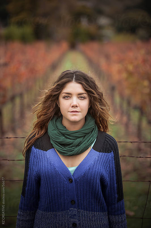 Portrait of a woman standing in a vineyard. by RZ CREATIVE for Stocksy United