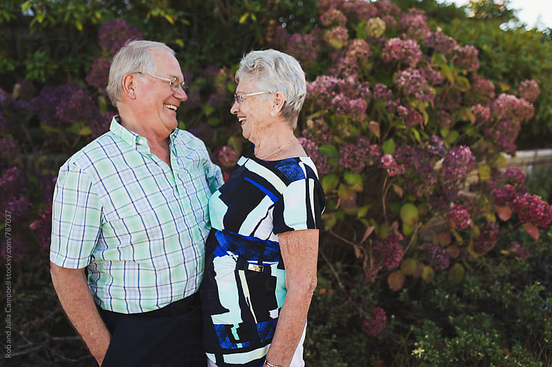 Happy senior couple outside enjoying life together - laughing by Rob and Julia Campbell for Stocksy United