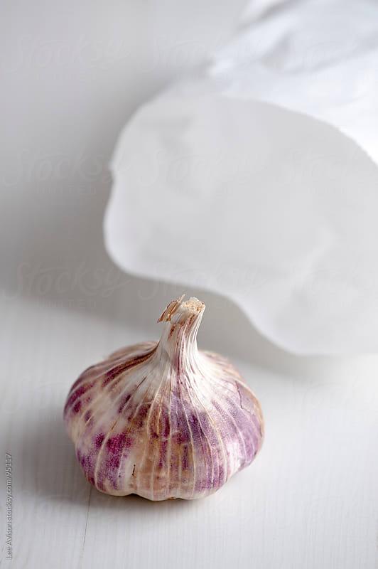 garlic bulbs by Lee Avison for Stocksy United