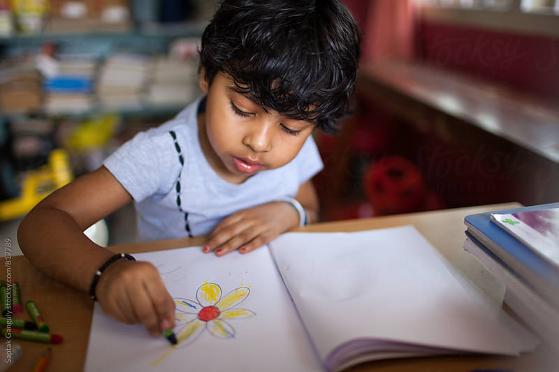 Cute little girl drawing picture by Saptak Ganguly for Stocksy United