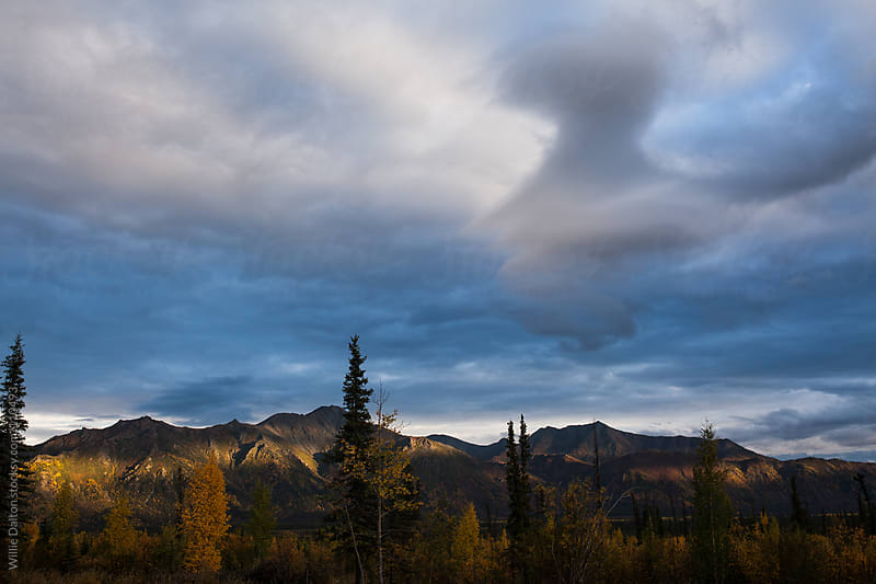 Etherial Sky with Setting Sunlight on Distant Mountains by Willie Dalton for Stocksy United