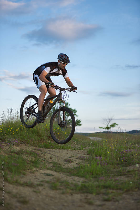 Man riding and jumping with his mountain bike outdoor by RG&B Images for Stocksy United