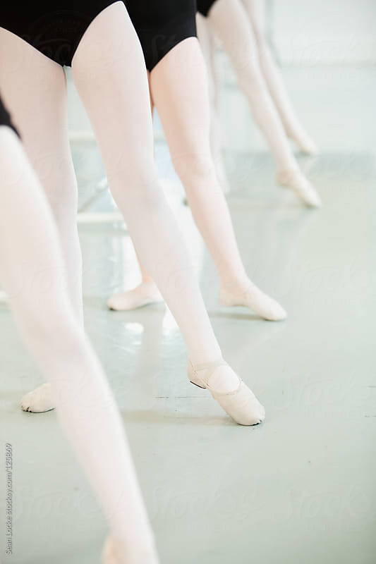 Ballet: Students Practice Pointing Toes by Sean Locke for Stocksy United