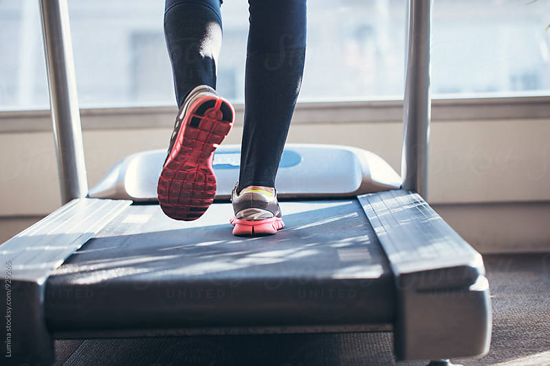 Legs of Woman Walking on a Treadmill by Lumina for Stocksy United