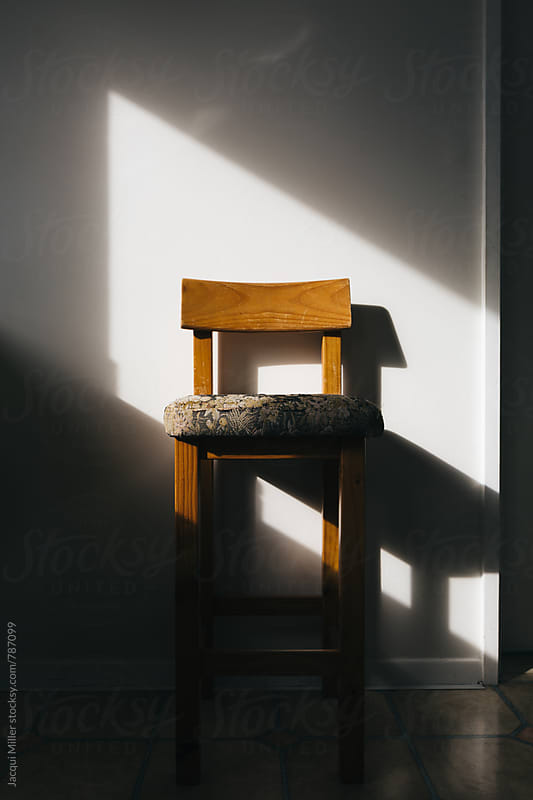 Old Chair in kitchen with harsh directional light by Jacqui Miller for Stocksy United
