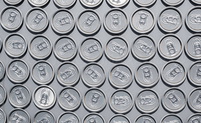 Repetition of plugs/tops of soda cans.  by Marko Milanovic for Stocksy United
