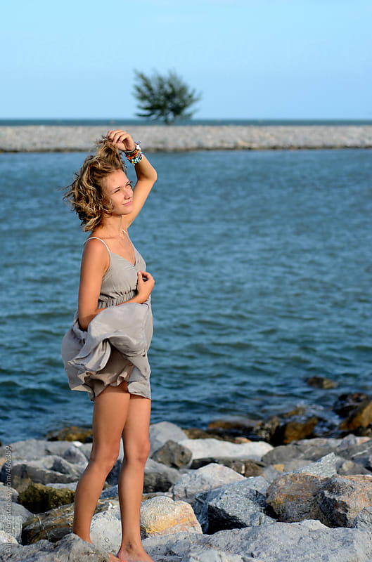 Young lady at the seaside  by Alice Nerr for Stocksy United