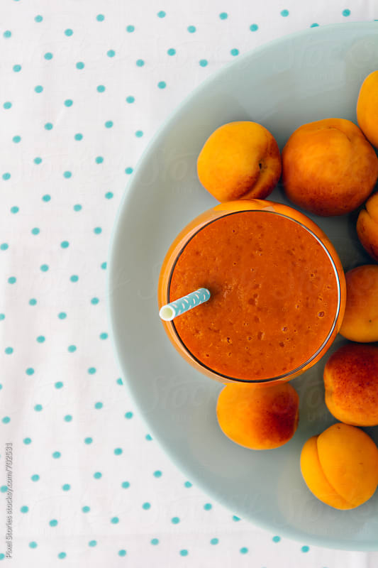 Apricot smoothie by Pixel Stories for Stocksy United