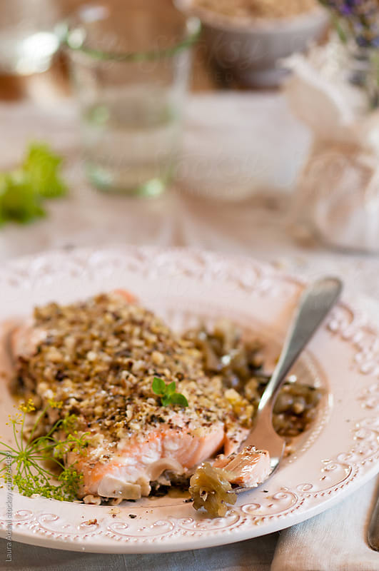 fillet of salmon with hazelnut and wild fennel by Laura Adani for Stocksy United