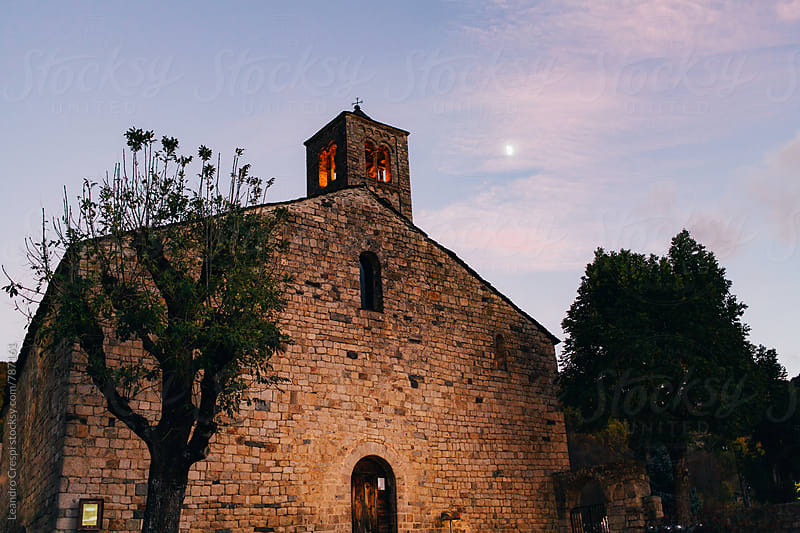 A stone build church in an autumn afternoon by Leandro Crespi for Stocksy United