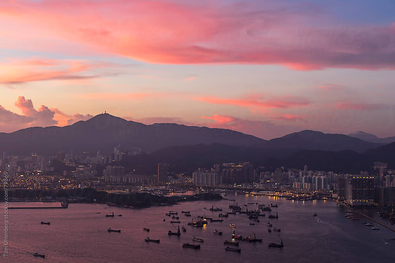 Ships Moored at Hong Kong's Victoria Harbour at Sunset by Tom Uhlenberg for Stocksy United