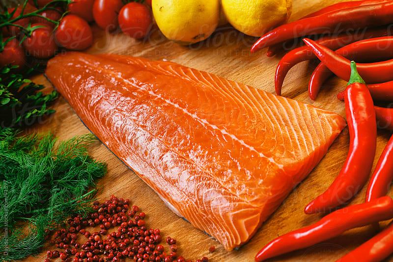 Raw salmon fillet by Davide Illini for Stocksy United