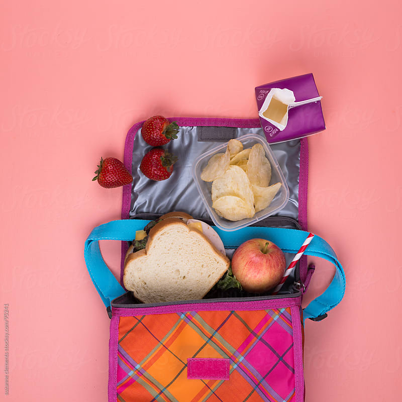 Child's Lunch Sack Spilled Open to Reveal Their Meal by suzanne clements for Stocksy United