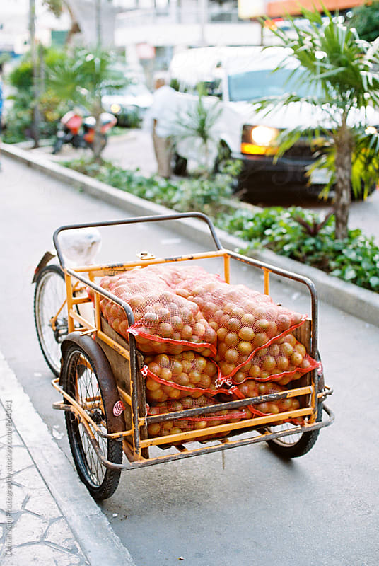 Cart of oranges by Daniel Kim Photography for Stocksy United