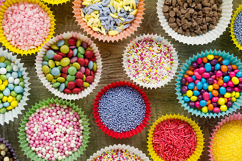 Cake decorations and sprinkles, overhead by Kirsty Begg for Stocksy United