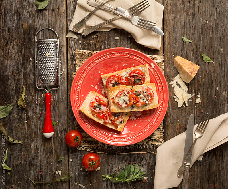Crostini with Tomato, Parmigiano Reggiano and Herbs by Studio Six for Stocksy United