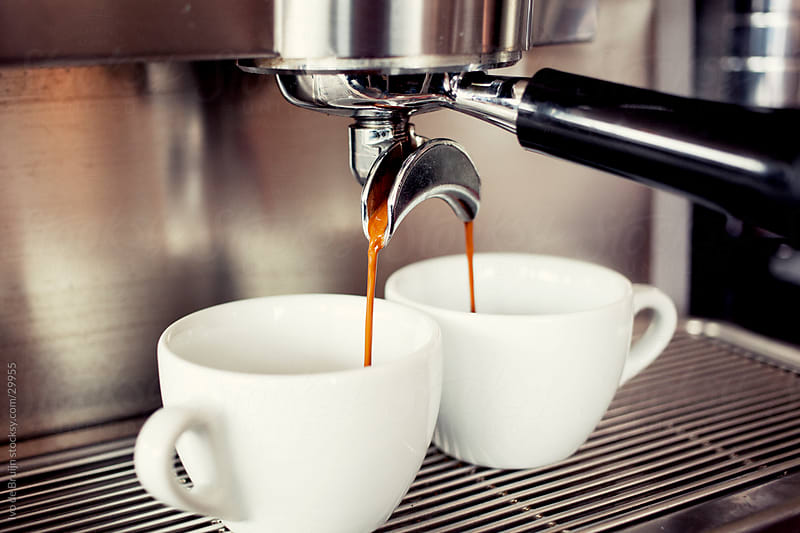 Freshly made quality coffee dripping into two coffee cups by Ivo de Bruijn for Stocksy United