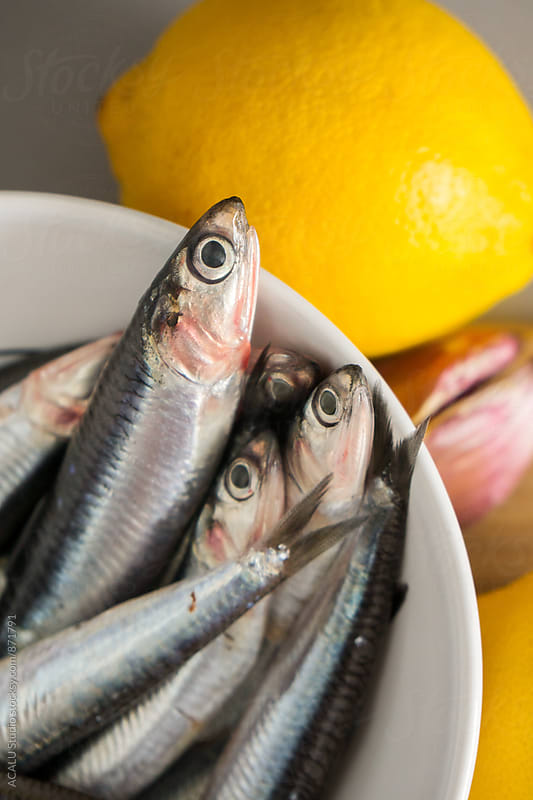 Anchovies with lemon and garlic by ACALU Studio for Stocksy United